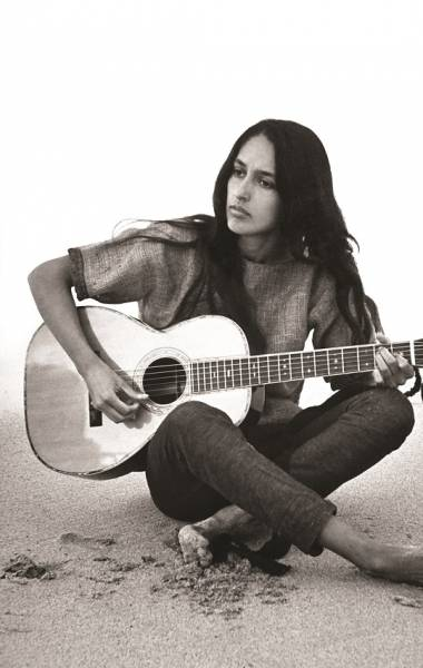 Folk singer Joan Baez strumming her guitar on the beach near her home.  (Photo by Ralph Crane//Time Life Pictures/Getty Images)